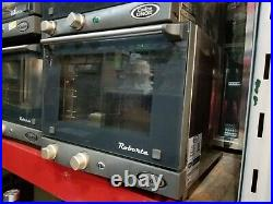 Cadco Quarter Size Countertop Electric Convection Oven with 3 Quarter Size racks